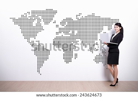Global business concept - business woman using laptop computer with world map