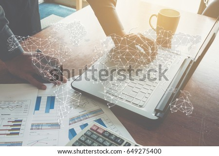 Global business concept: Businessman working with laptop