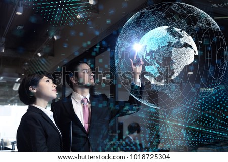 Global business concept. Young business persons watching GUI of world map. #1018725304