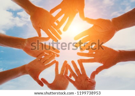 global community of people, support, group of volunteers gathering hands together