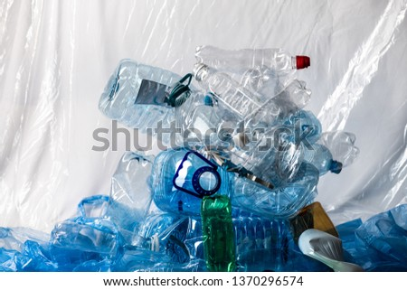 Global consumption. Big plastic mountain made of empty water bottles and representing state of our ecology #1370296574