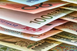 Global currency / forex, foreign money exchange concept : Paper banknotes from around the world e.g AUD 20 Australian dollar, EUR 100 euro, CNY 100 Chinese yuan, JPY 10000 Japanese yen, US 100 dollar