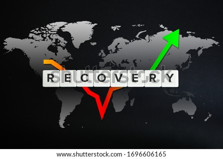 Photo of  Global economy recovery concept. Financial, industrial, business and market sector comeback and upturn. Block letters, stock chart and world map on black background.