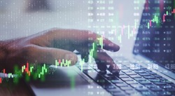 Global finance trading with forex digital screen with man hand typing on laptop keyboard.Double exposure.