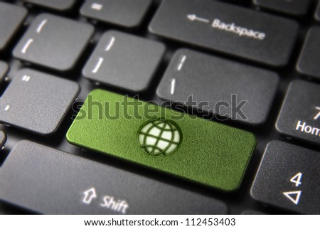 Global go green key with earth icon on laptop keyboard. Included clipping path, so you can easily edit it.