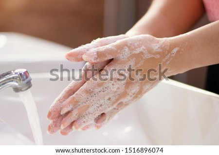 Global Handwashing Day Concept/Washing of hands with soap in bathroom.