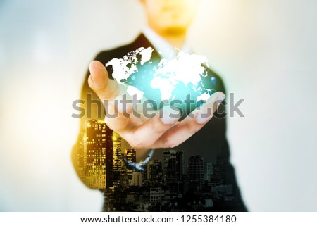 Global Marketing, International trading doing business internationally is open to the whole world.Businessman stretch out hand.