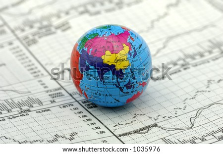 Global Markets Concept - Stock Charts and a Globe