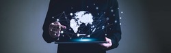 Global network communication connection concept, Man holding digital tablet and pointing finger to graphic hitech earth