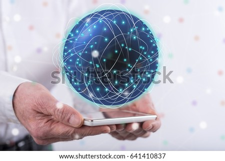 Global network concept above a smartphone held by hands #641410837