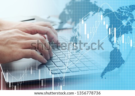 Photo of  Global stock market concept. Using laptop for stock exchange.
