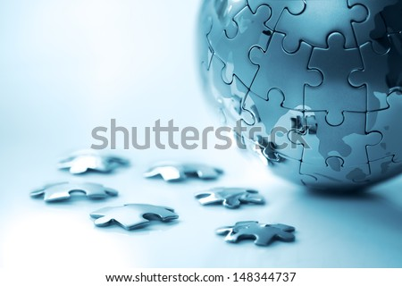 Global strategy solution concept - earth jigsaw puzzle