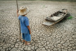 Global warming, Children with boat on cracked earth after the climate change