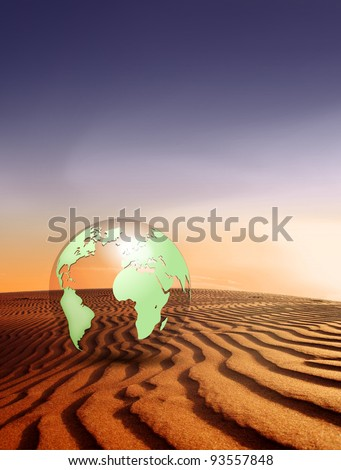 Global warming concept - climate change - desert landscape and globe with nature background