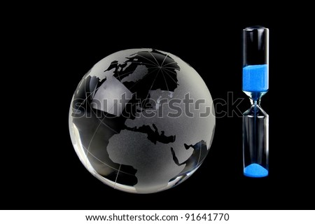Globe and blue sand hourglass
