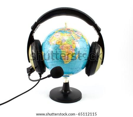 globe and headphones isolated on white background