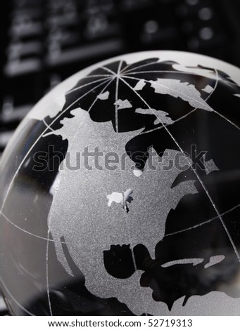 globe and keyboard showing global communication or internet concept