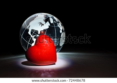 Globe and red heart for background - stock photo