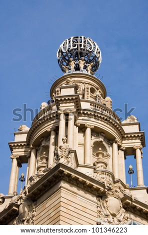Globe and tower at the historic Coliseum theatre in Westminster, London.  One time music hall, now home to English National Opera. Building over 100 years old, viewed from pavement.