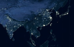 Globe at night, view of city lights in India, China, South Korea, Malaysia and Japan from space. Asia dark lands in global satellite photo. Part of flat World map. Elements of image furnished by NASA