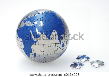 Globe collected from puzzle parts isolated on white