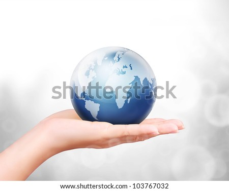 Globe ,earth in human hand against
