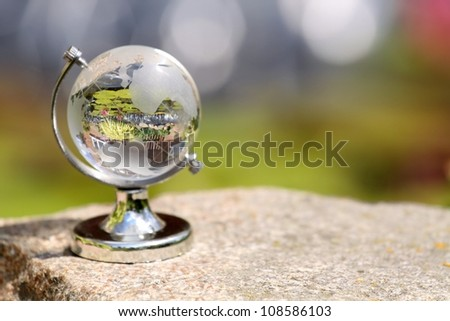 Globe glass on rock, environment concept