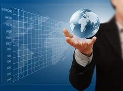 Globe in hand, businessman
