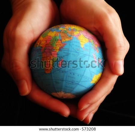 Globe in hands.