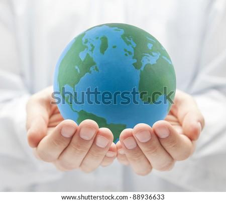 Globe in hands