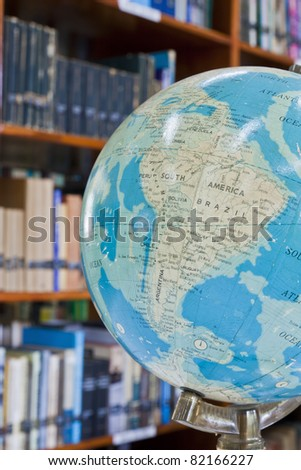 Globe in library with blurred background