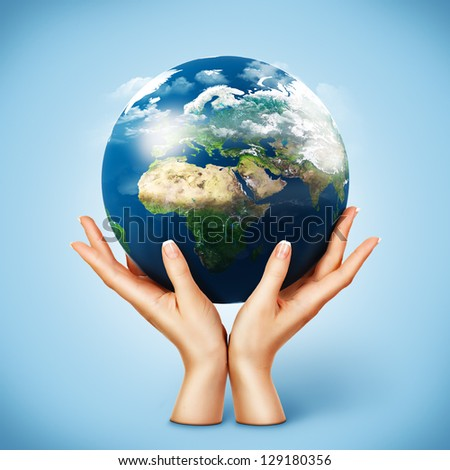 Globe in women's hands. Elements of this image furnished by NASA