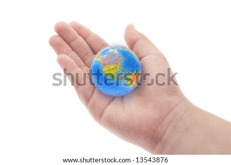 Globe in young boy's hand on white background
