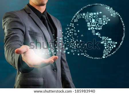 globe made by icon floating from businessman hand