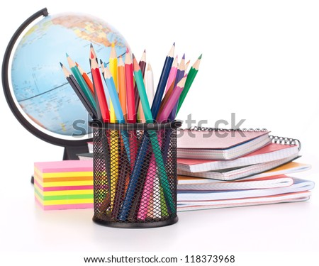 Globe, notebook stack and pencils. Schoolchild and student studies accessories. Back to school concept.