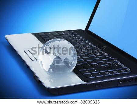 globe on a laptop keyboard - stock photo