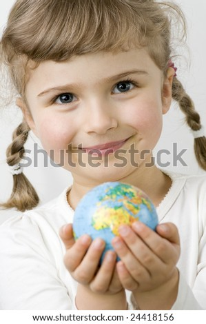 Globe on child hands