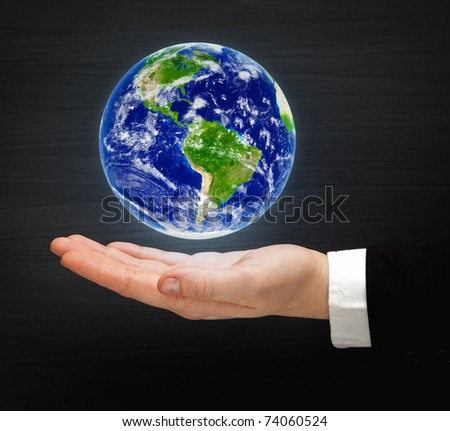 globe on the hand
