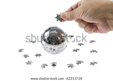 Globe puzzle and hand on isolated white
