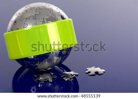 Globe puzzle with reflector on blue background.