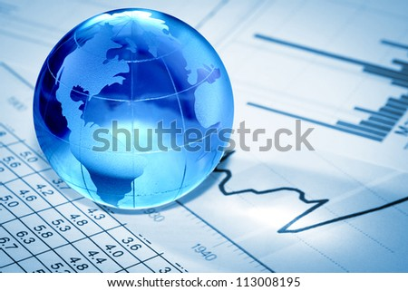Globe showing North America and resting on financial papers
