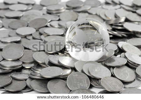 Globe staying on coins. money concept