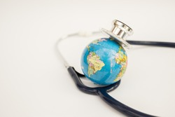 Globe with a stethoscope wrapped around it. Save the wold/ Green Earth day concept.