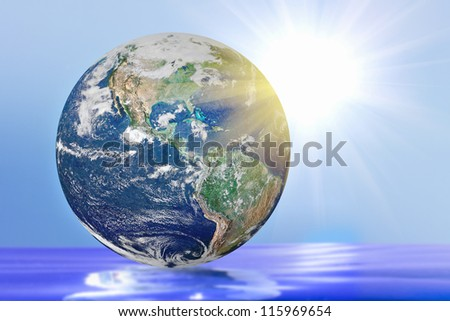 globe with bright highlights on a blue background. Elements of this image furnished by NASA