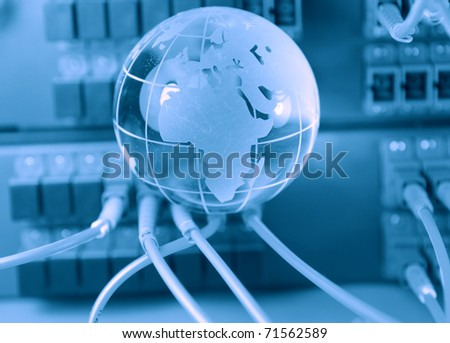 globe with network cables and servers in a technology data center