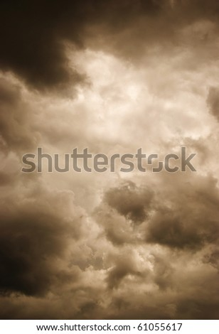 Gloomy clouds have shrouded the sky before a thunder-storm. Stylized photo