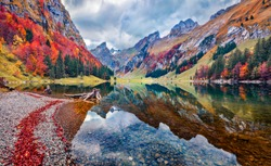 Gloomy morning view of Seealpsee lake. Astonishing autumn scene of Swiss Alps. Majestic Santis peak reflected in the calm surface of pure water lake. Beauty of nature concept background, Switzerland.