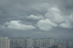 Gloomy storm clouds over city