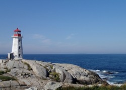 Glorious morning long shot of Peggy's Cove, Nova Scotia, rocks and calm sea