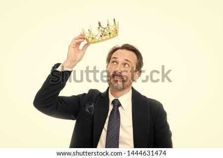 Glory seeking man. Senior man representing power and triumph. Business king. Mature businessman holding crown. Success in business. King of style. Achieving victory and success. Fit for a king.